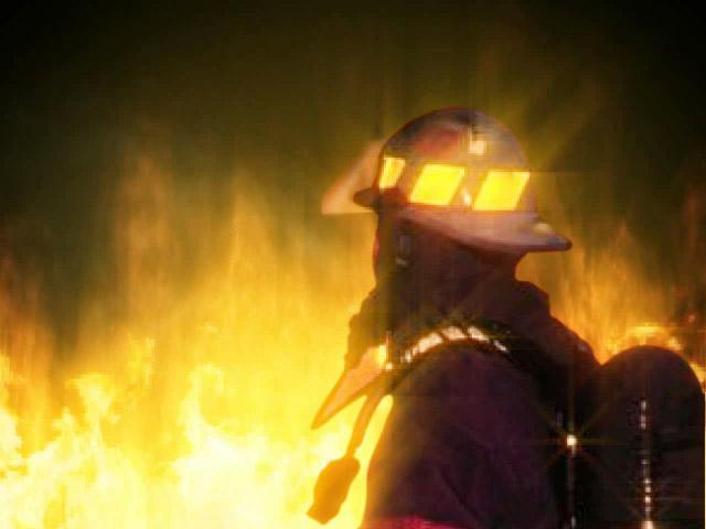 firefighter looking away_1521465907627.jpg.jpg